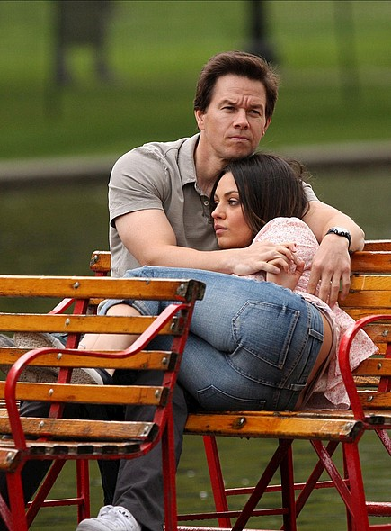 Mila Kunis and Mark Wahlberg cuddle