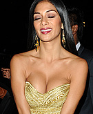tn nicole scherzinger 20 Nicole Scherzinger nearly busts out of her dress in London.