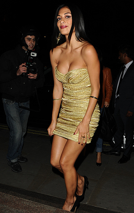 tn nicole scherzinger 24 Nicole Scherzinger nearly busts out of her dress in London.