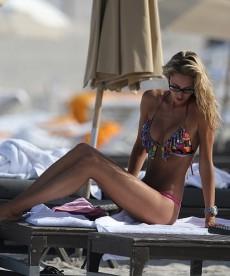 Lauren Stoner Relaxes On The Beach