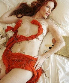 Phoebe Price Poses In Bed