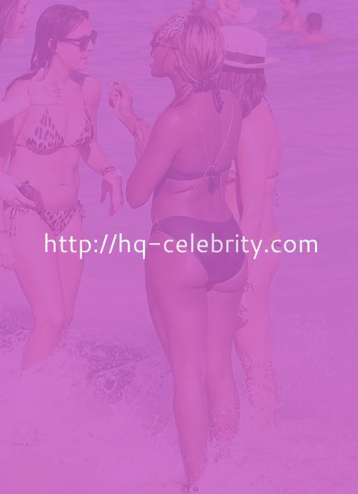 Alexandra Burke shows off her bikini body.