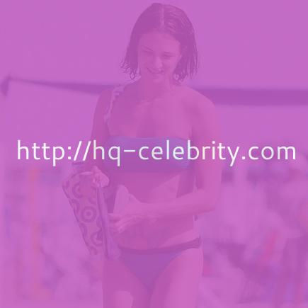 Asia Argento in blue strapless bikini