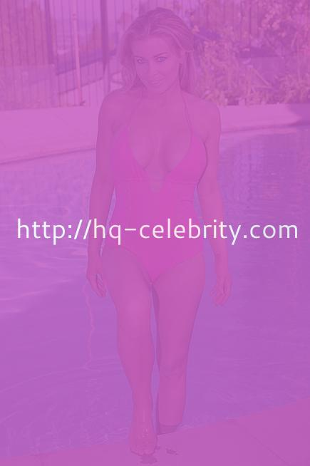 Carmen Electra shows off the girls in a pink one piece.