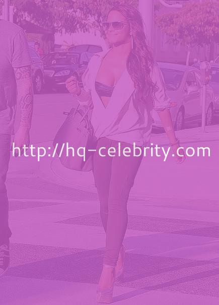 Christina Milian steps out in stretch pants