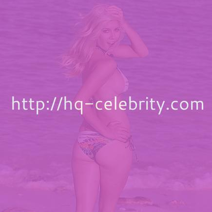 Heidi Montag covers her ass with colorful bikini