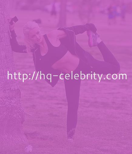 Gorgeous Holly Madison stretches before her workout