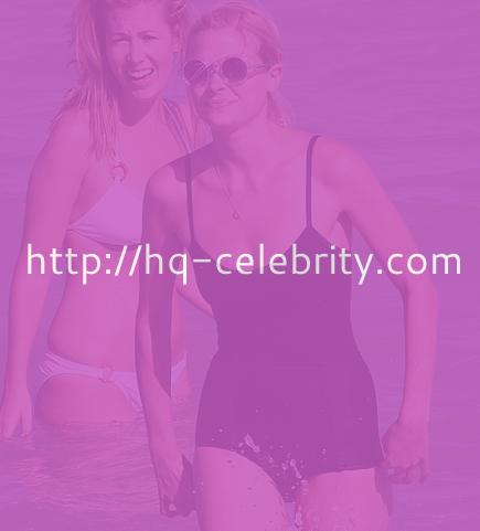 Jaime King in modest black swim suit