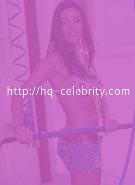Jasmine Waltz washes a car in a bikini