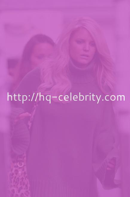 Jessica Simpson in a green sweater dress