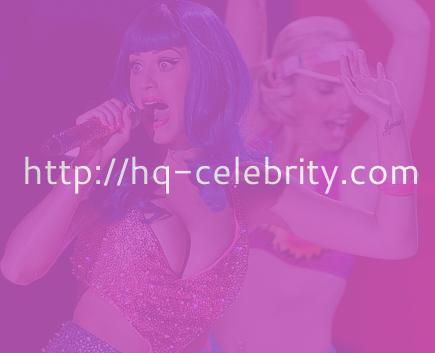 Katy Perry rocks a blue wig and killer cleavage