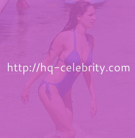 Kelly Brook in two body baring bathing suits