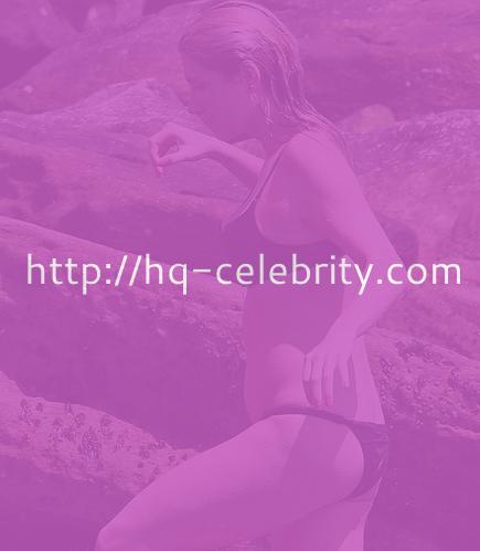 Kesha wears a black bikini in Sydney
