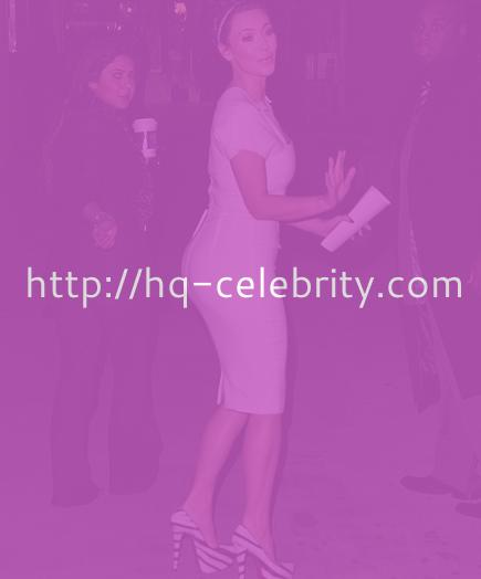 Kim Kardashian in body hugging white dress