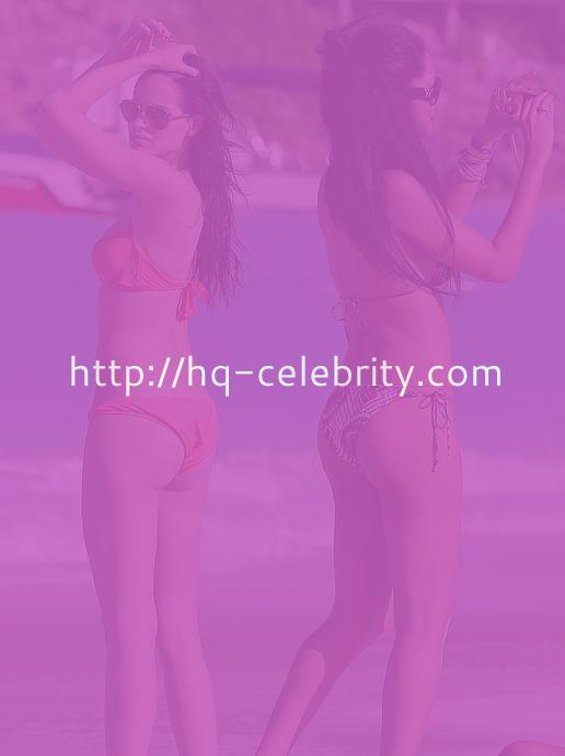 Kimora Lee Simmons and Hana Nitsche hang out on the beach.