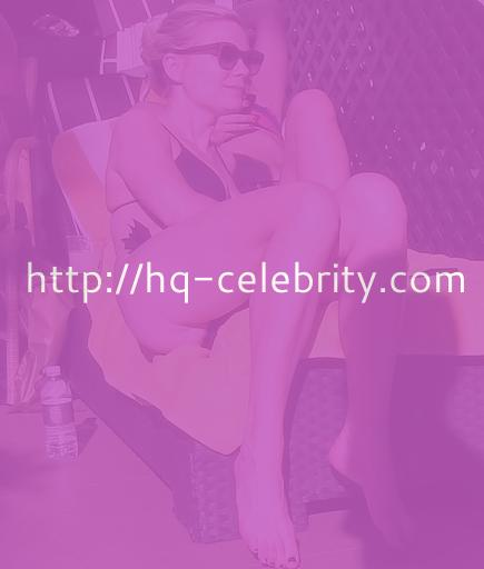 Kirsten Dunst relaxing in a bikini