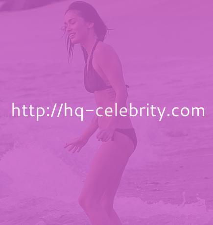 Megan Fox hits the beach in a black bikini