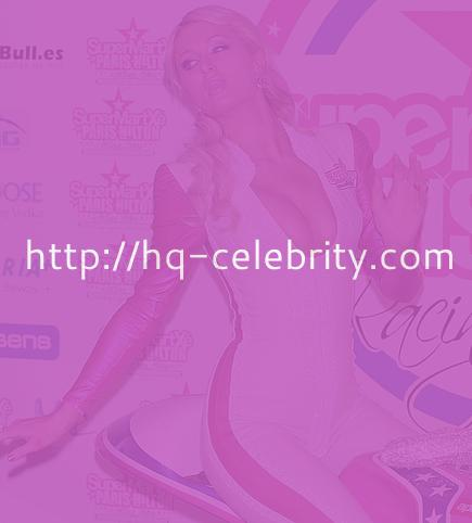 Paris Hilton shows off her boobs