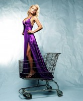 Jessica Simpson poses in a shopping cart
