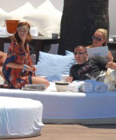 Natasha Hamilton relaxes by the sea