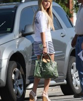 Ashley Tisdale in mini skirt