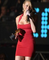 Mariah Carey wearing a red dress