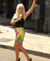 Christina Aguilera in short dress and heels