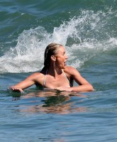Cameron Diaz showing a lot of skin on the beach in Malibu