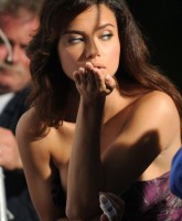 Adriana Lima blowing a kiss