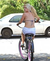 Sophie Monk bicycling in a bikini