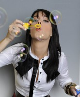 Katy Perry blowing bubbles
