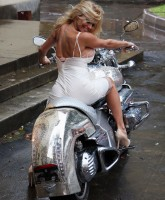 Pamela Anderson on a bike