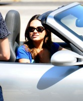 Mila Kunis shows bust in Extract