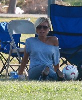 Victoria Posh Spice Beckham Plays with the Ball