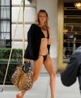Angela Lindvalls black bikini and heels