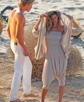 Gisele Bundchen & topless male shoot away