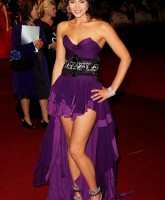 Gemma Arterton in skimpy purple dress