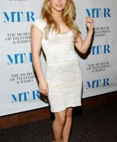 Hayden Panettiere posing in white dress