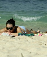 Evangeline Lilly sunbathing
