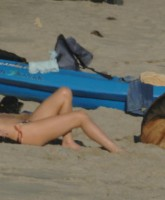 Charlize Theron in bikini on the beach in Malibu