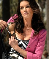 Janice Dickinson Adjusts Bra in Public