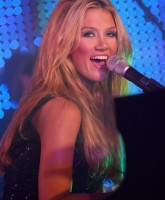 Delta Goodrem barefoot at the piano