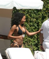 Melanie Brown in black and at the poolside