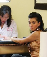 Kim Kardashian having manicure