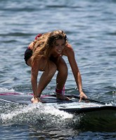 Denise Richards surfing