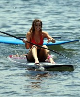 Denise Richards surfing in Maui