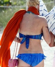 Lindsay Lohan Flashes Some Under Boob
