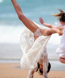 Miranda Kerr Frolics On The Beach In Lingerie